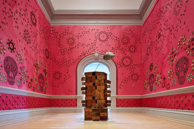 A pink interior room with bugs displayed on the walls for the WONDER exhibition at the Renwick Gallery. (8 of 18)
