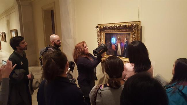 This is a picture of Conservator Amber Kerr describing conservation work on artwork in the collection.