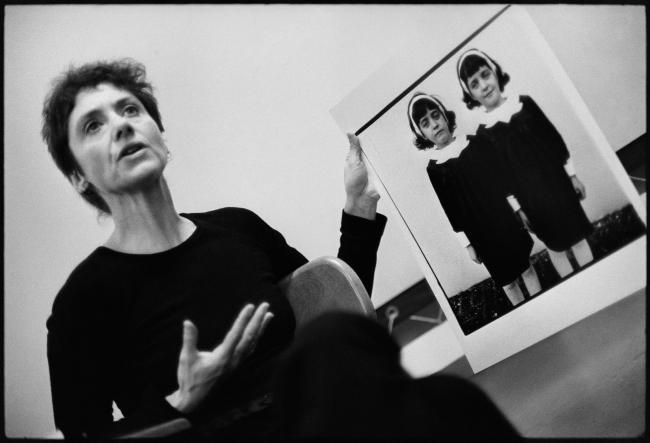 Diane Arbus with her photograph, Identical Twins