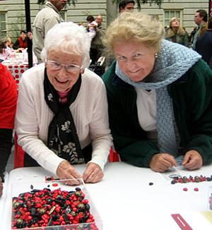 Shirley and Catherine at the Festival's Bead Making Station