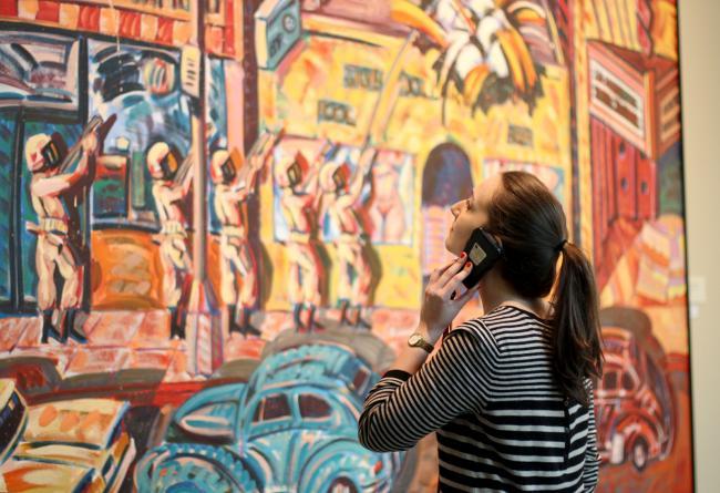 A woman listening to an audio tour on her phone
