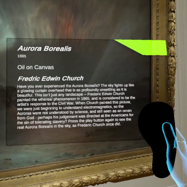 An artwork with the northern lights and a remote controller with text over the artwork.
