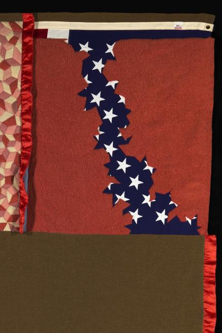 A quilt made of multiple materials.
