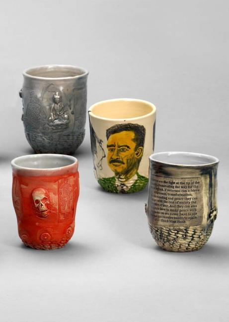 A photograph of four ceramic mugs.
