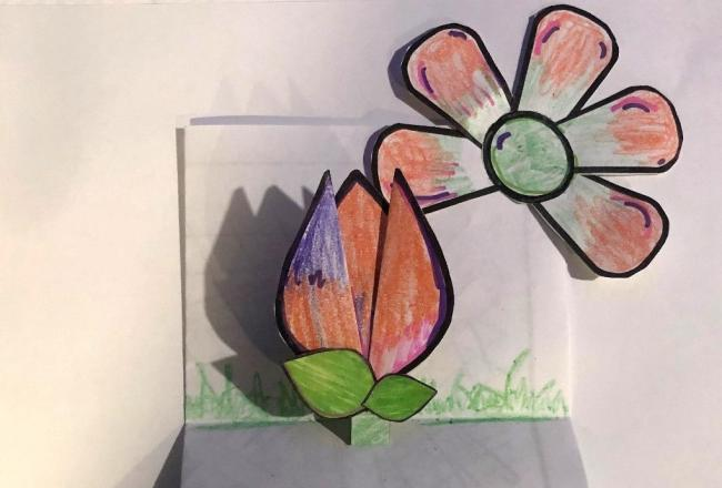 An arts and craft flower made of paper.