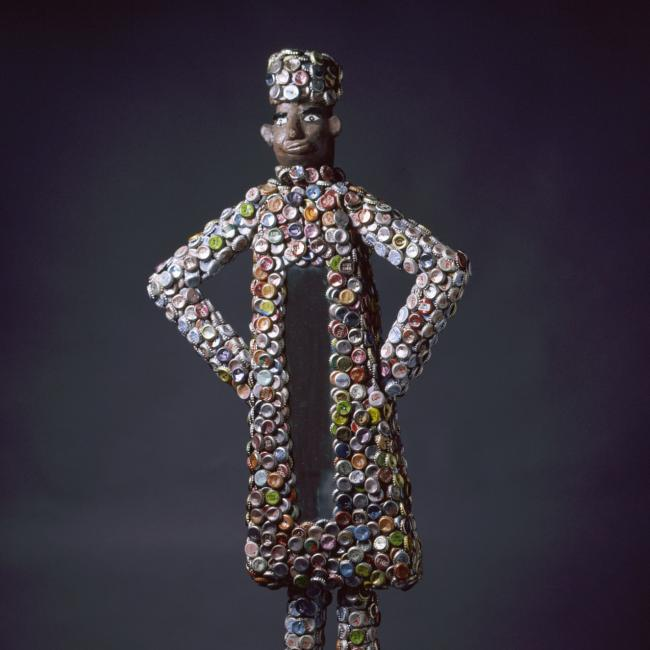 A photograph of an artwork made from bottle caps