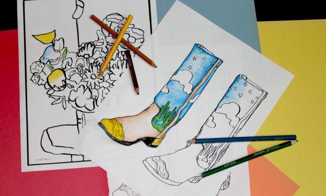 A photograph of coloring pages with colored pencils