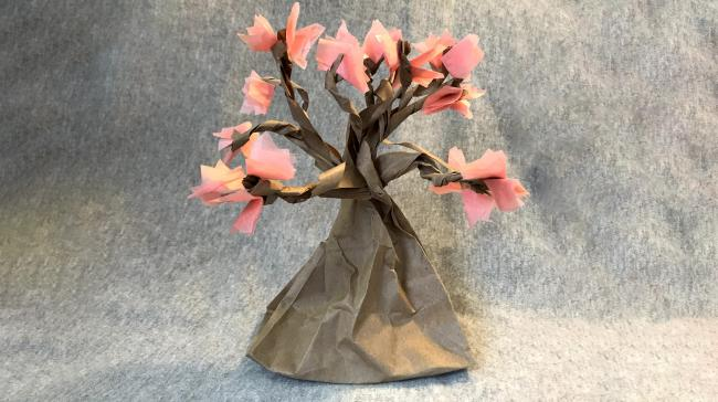 A cherry blossom tree made out of craft materials.