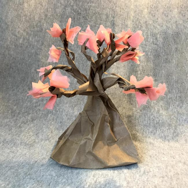 A cherry blossom tree made of crafting materials.