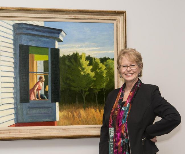 This is a photograph of Virginia Mecklenburg in front of an Edward Hopper painting.