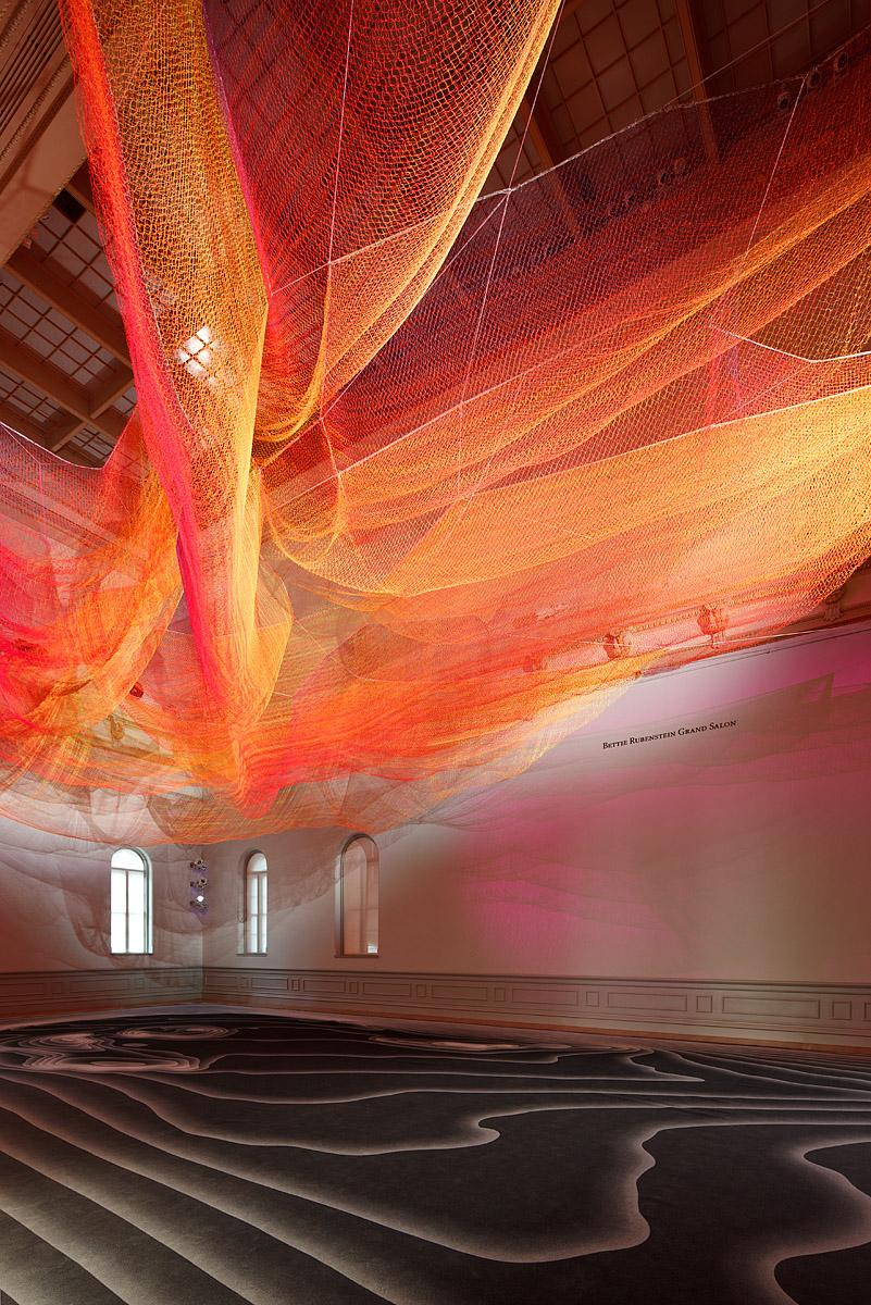 A photograph of a woven sculpture installed in the grand salon for WONDER at the Renwick Gallery.
