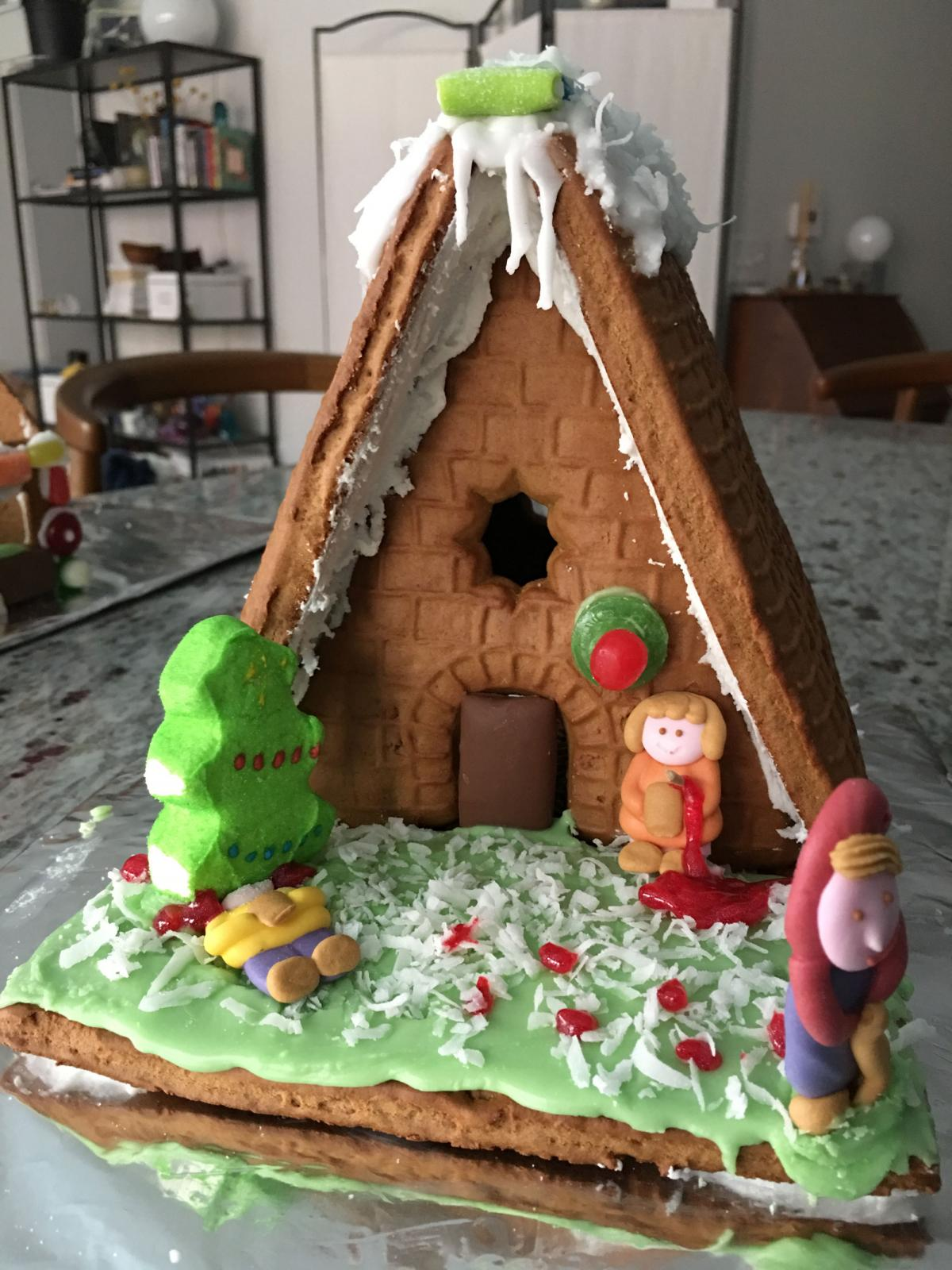 Gingerbread house decorated with candy.