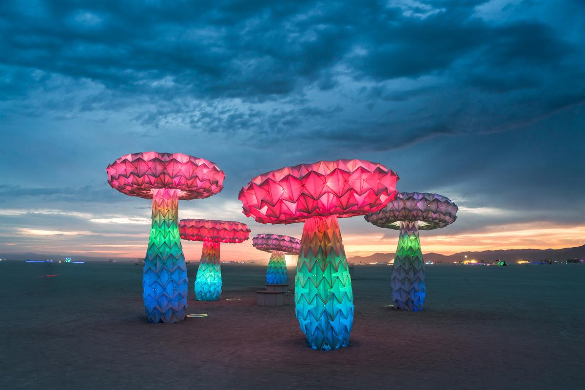 The sculpture piece, Shrumen Lumen, at Burning Man at night lit up.