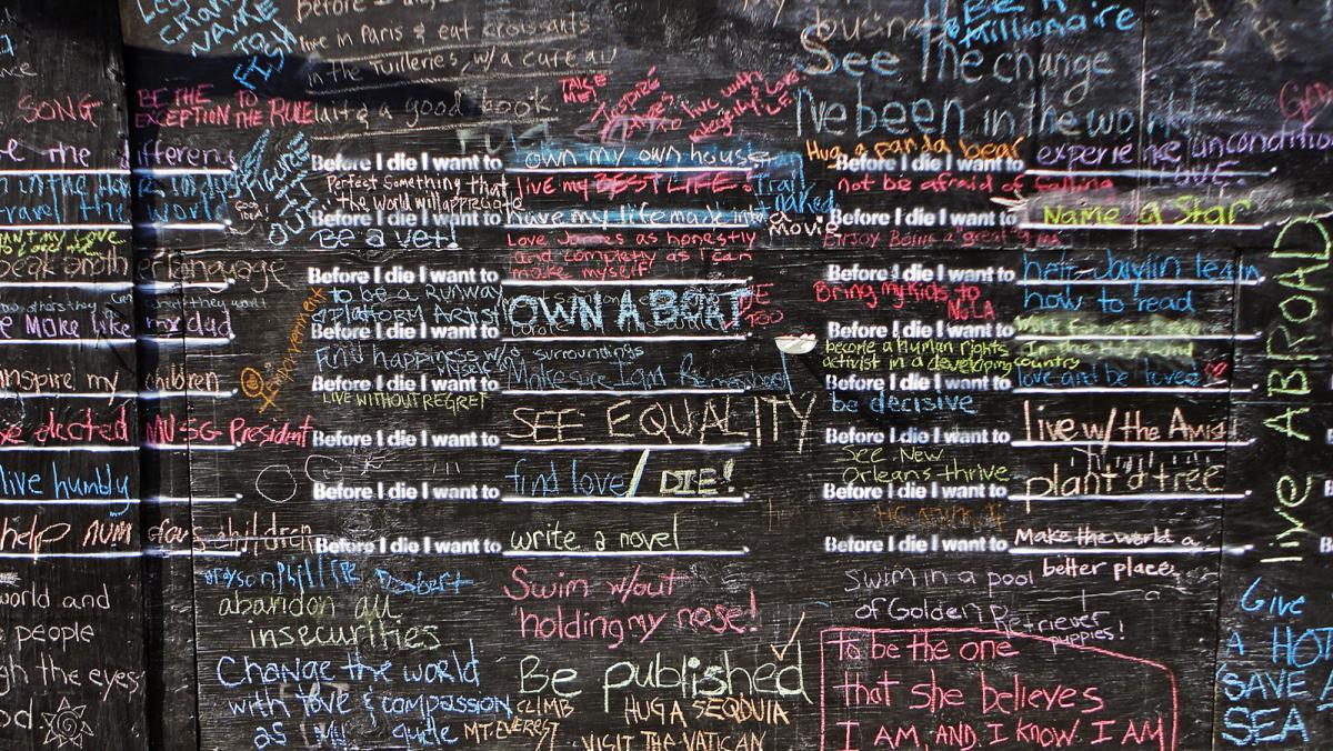 This is a detail of a chalkboard with writing on it by Candy Chang.