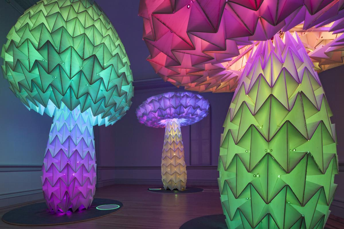 This is an image of three sculpture pieces that look like mushrooms inside the Renwick Gallery.
