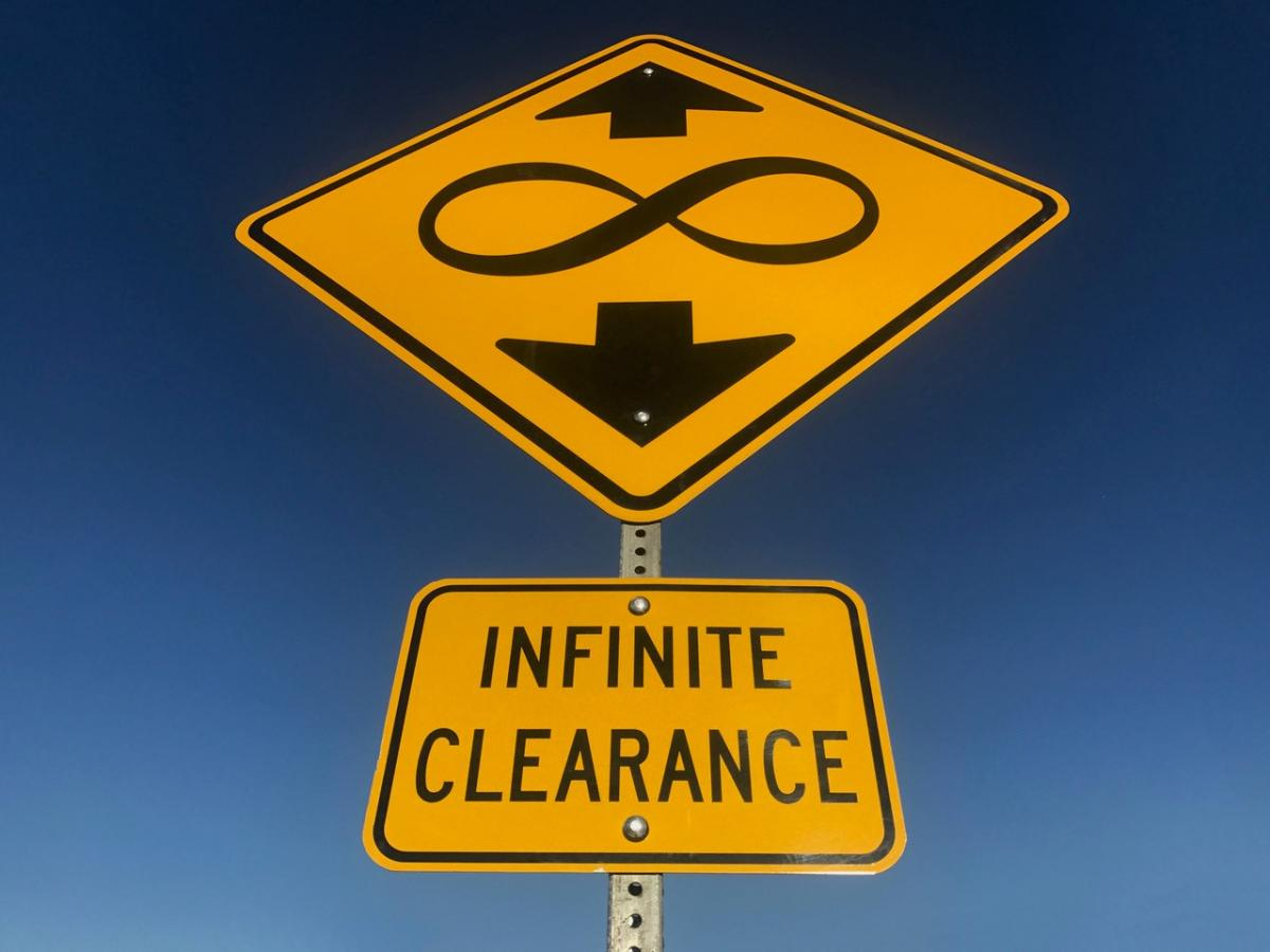 A picture of a yield sign with an infinity symbol on it.