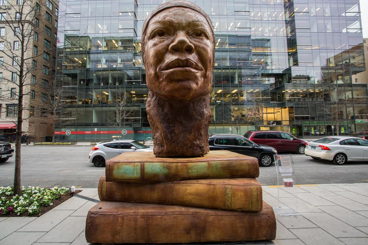 An image of Maya Angelou outside in the Golden Triangle district of D.C.