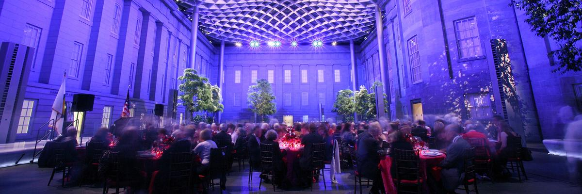 This is an image taken inside the Kogod Courtyard at the Smithsonian American Art Museum at night during an event.