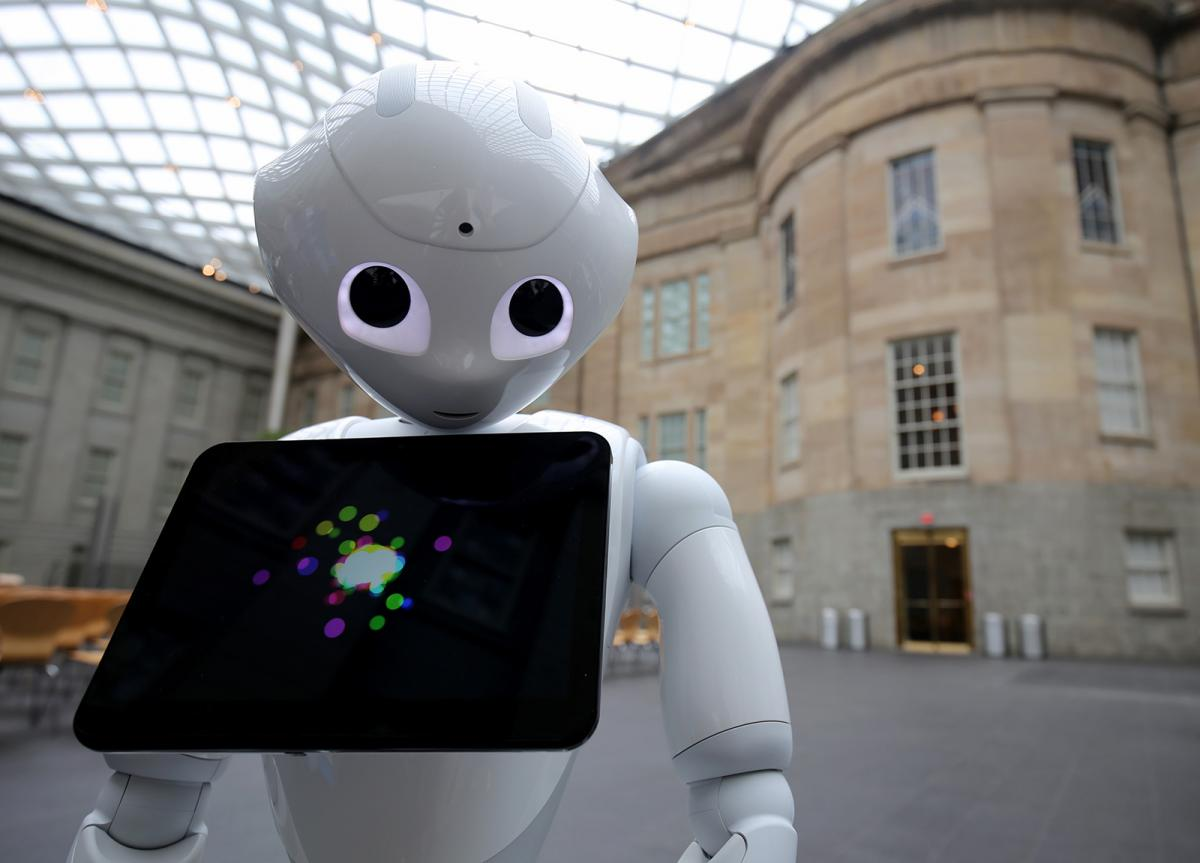 A photograph of Pepper the Smithsonian Robot inside the Kogod Courtyard at the Smithsonian American Art Museum.