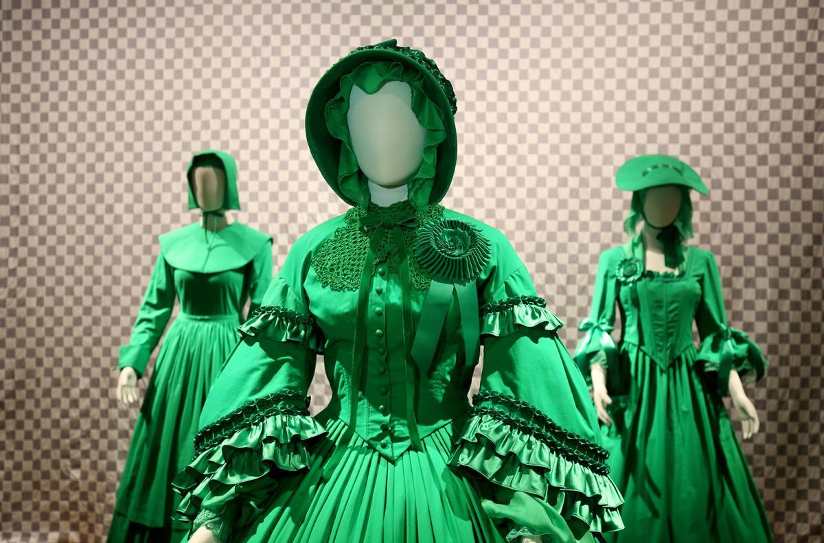 A photograph of three green chroma-key dresses.