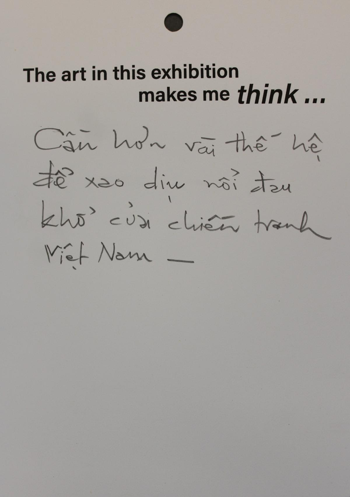 A visitor respond to the exhibition by writing in Vietnamese about the pain of the war