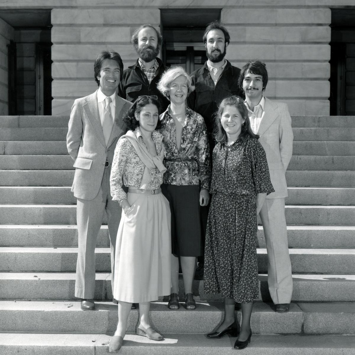 A photograph of seven people standing on stairs outside the Smithsonian American Art Museum.