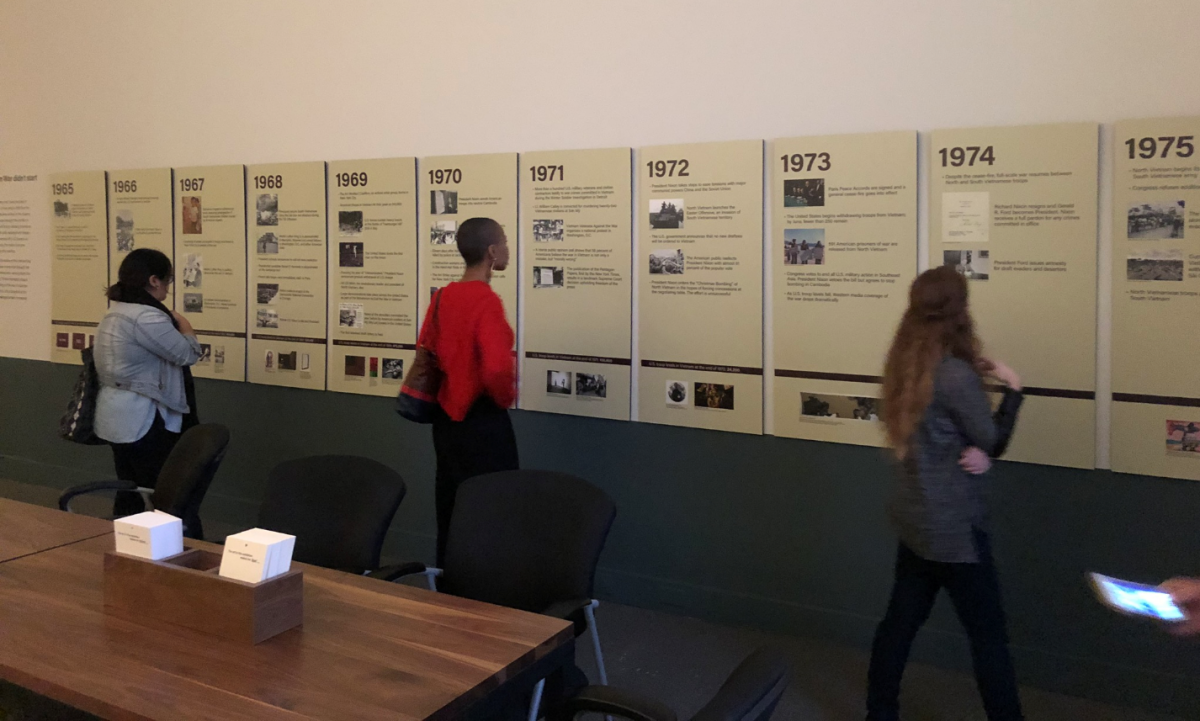 Visitors encounter the timeline in the exhibition, Artists Respond: American Art and the Vietnam War, 1965-1975