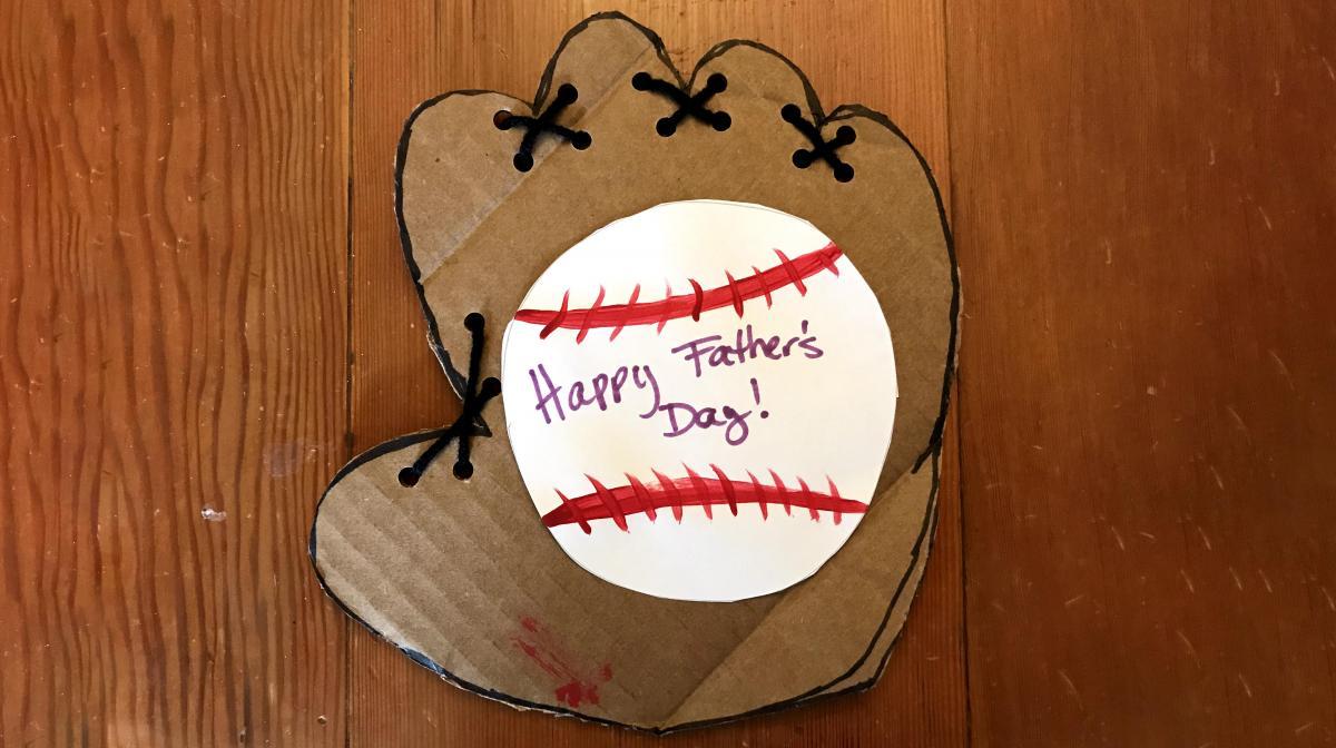 A photograph of a handmade card with a baseball
