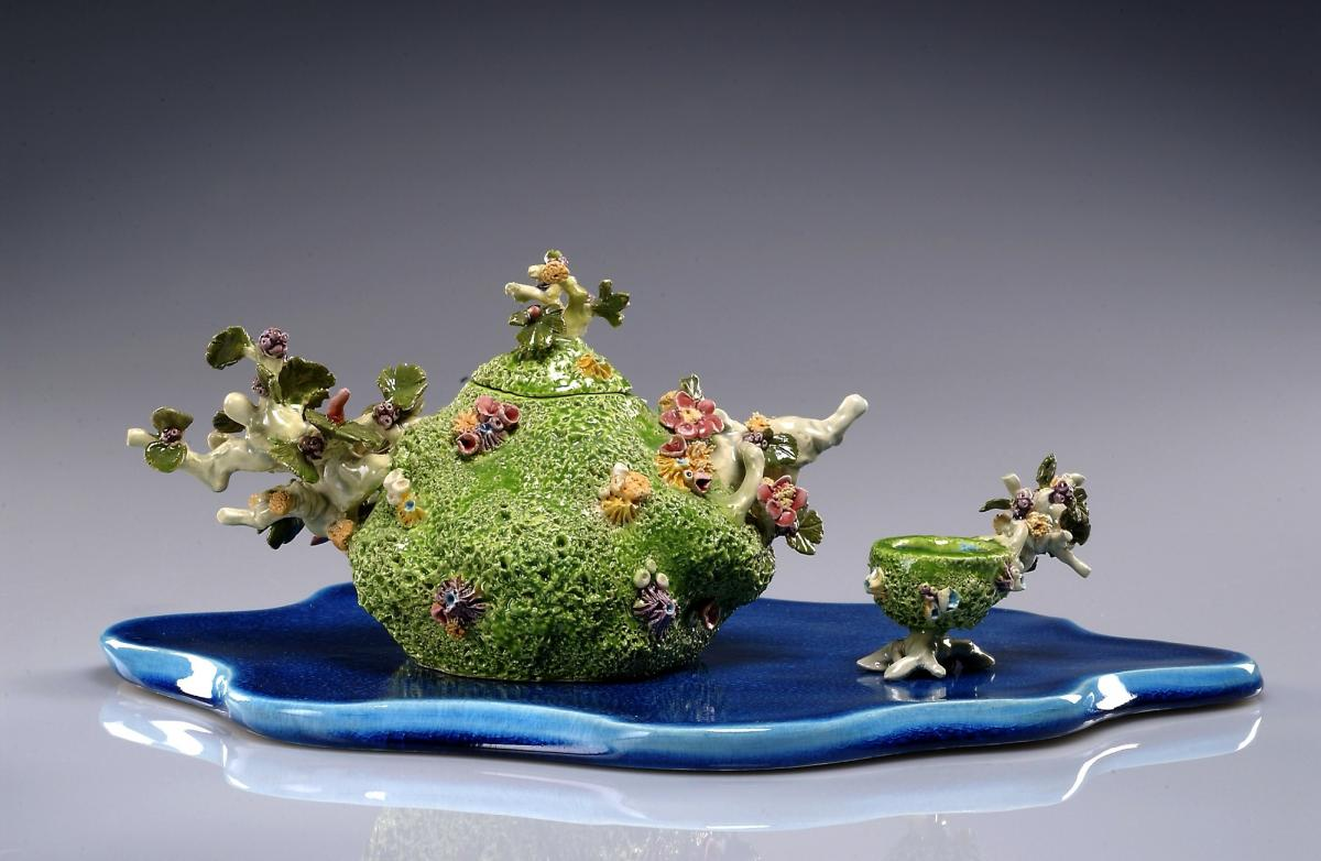 A ceramic tea pot made to resemble a coral reef.