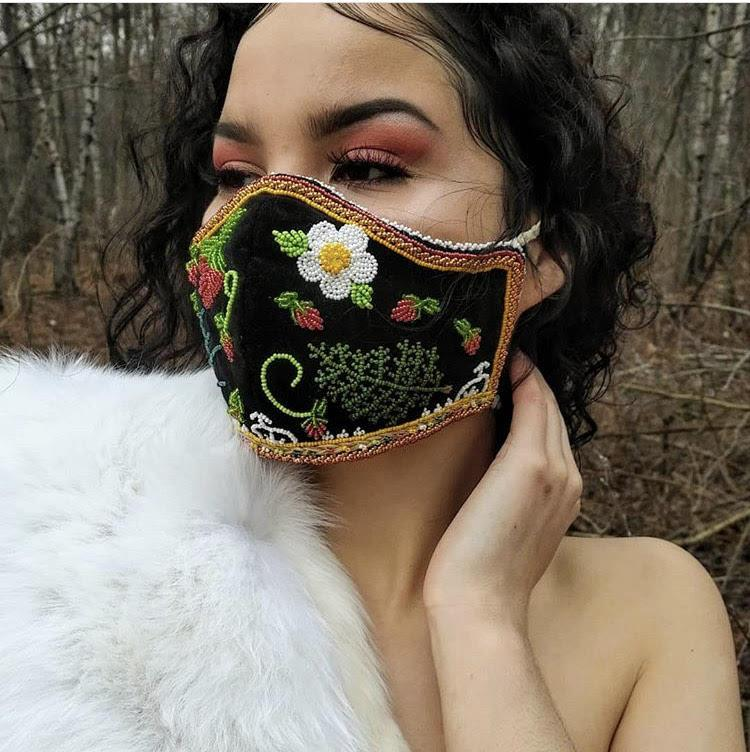 A photograph of a woman wearing a mask