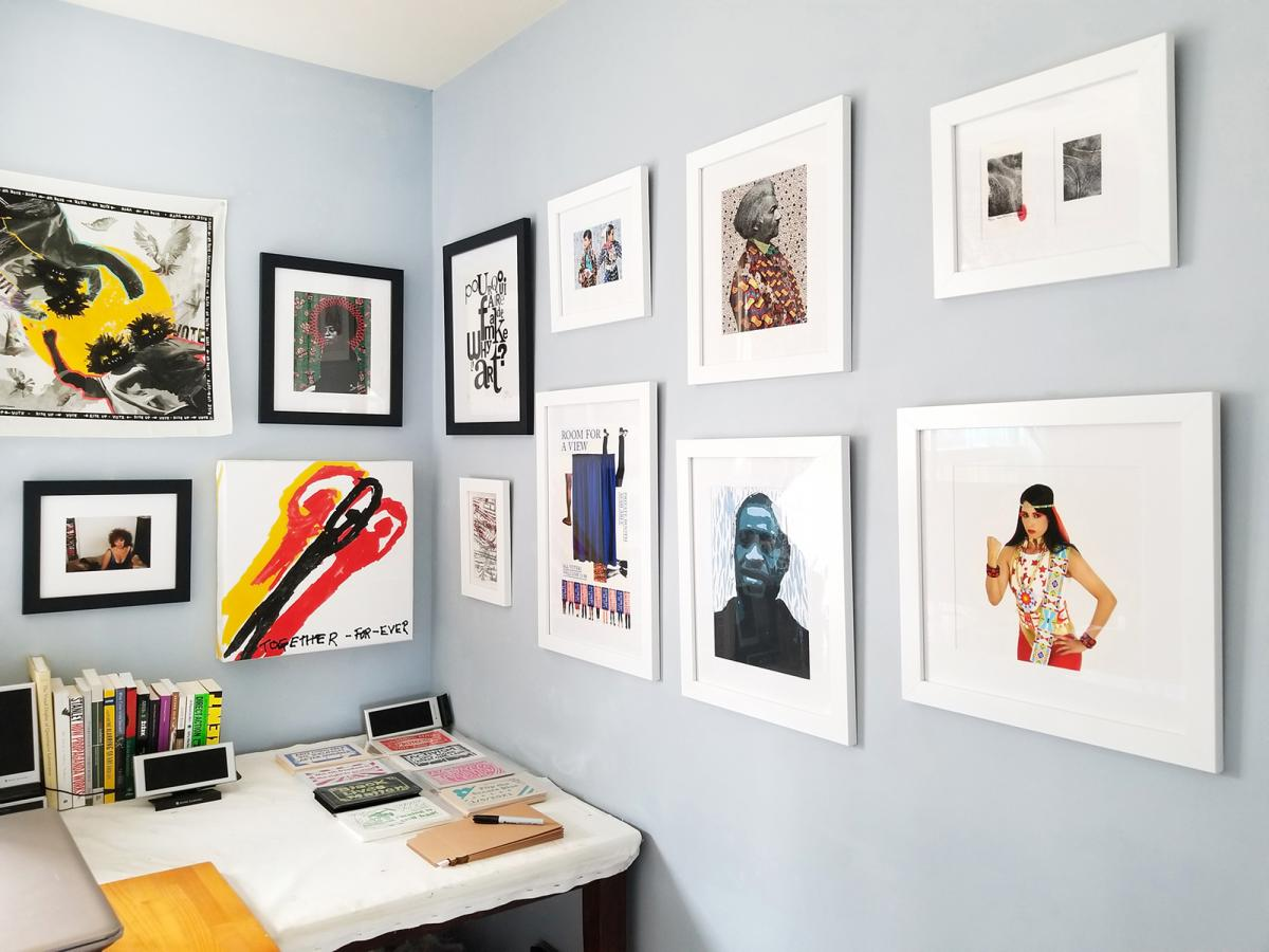 A photograph of a wall with artwork on it.