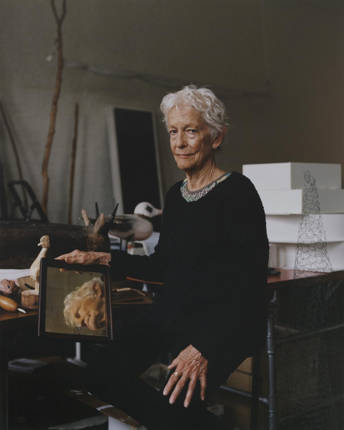 A photograph of a woman in a studio