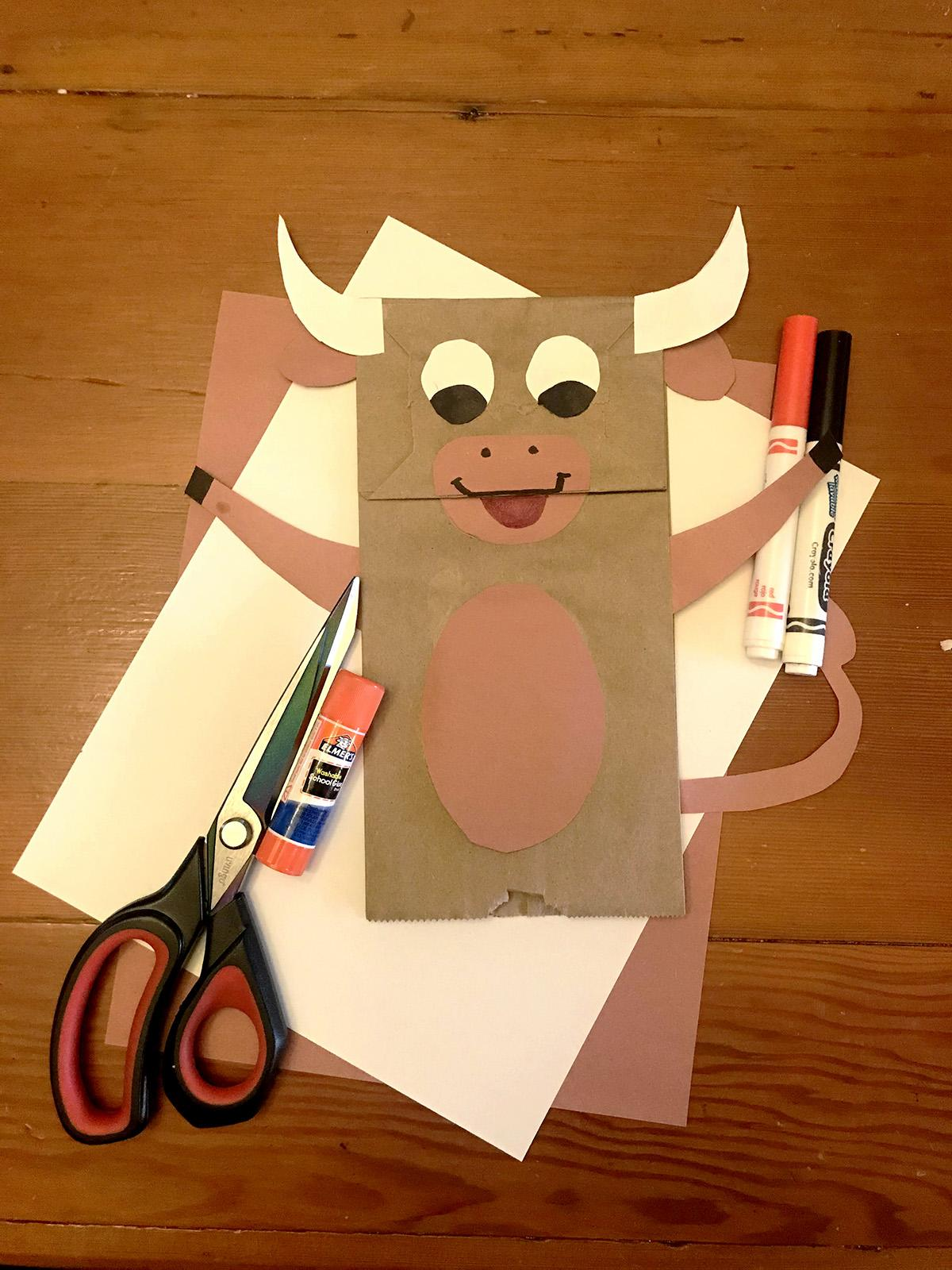 A photograph of a paper bag that looks like an ox.