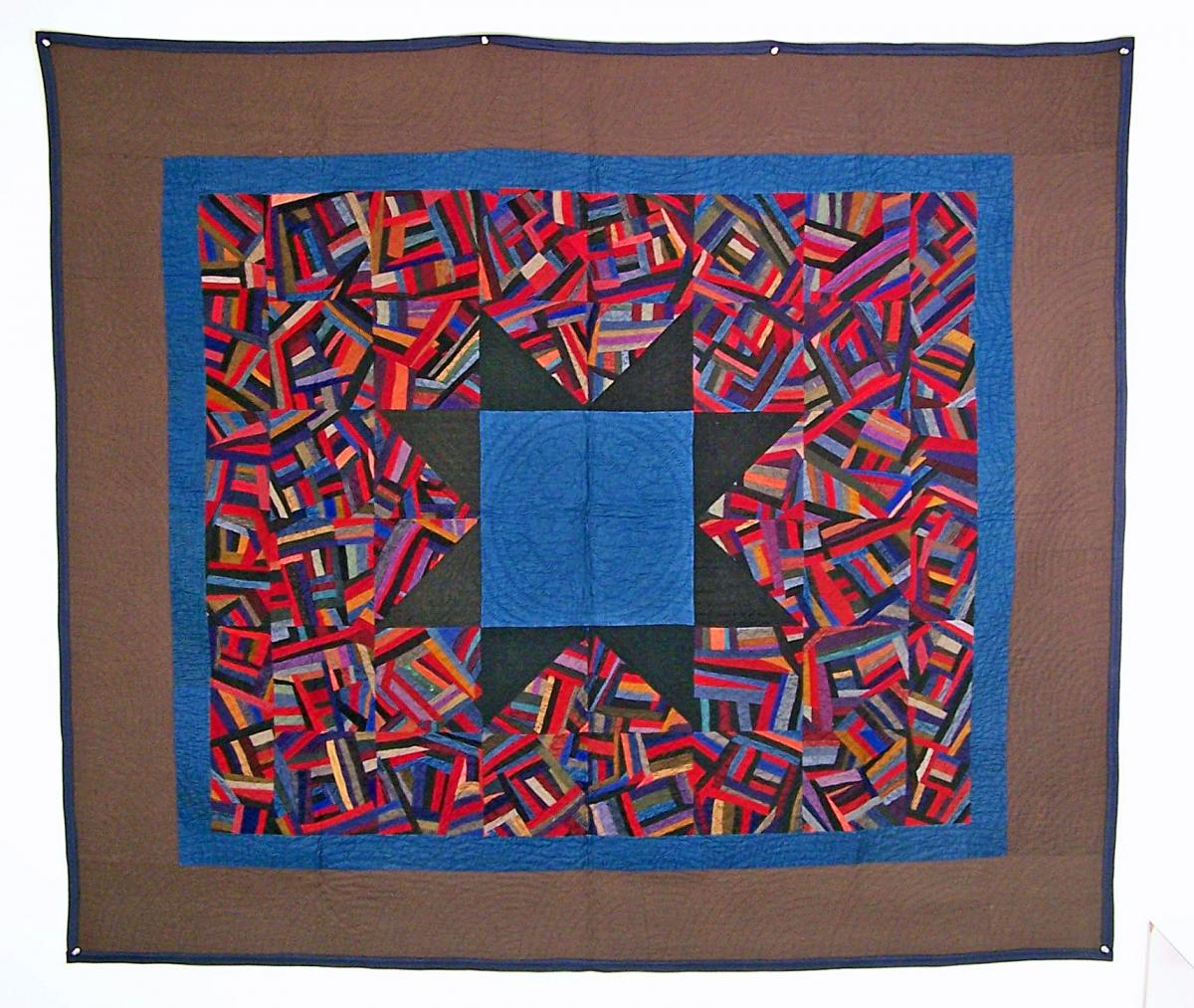 Crazy Star Quilt in brown, red, and blue