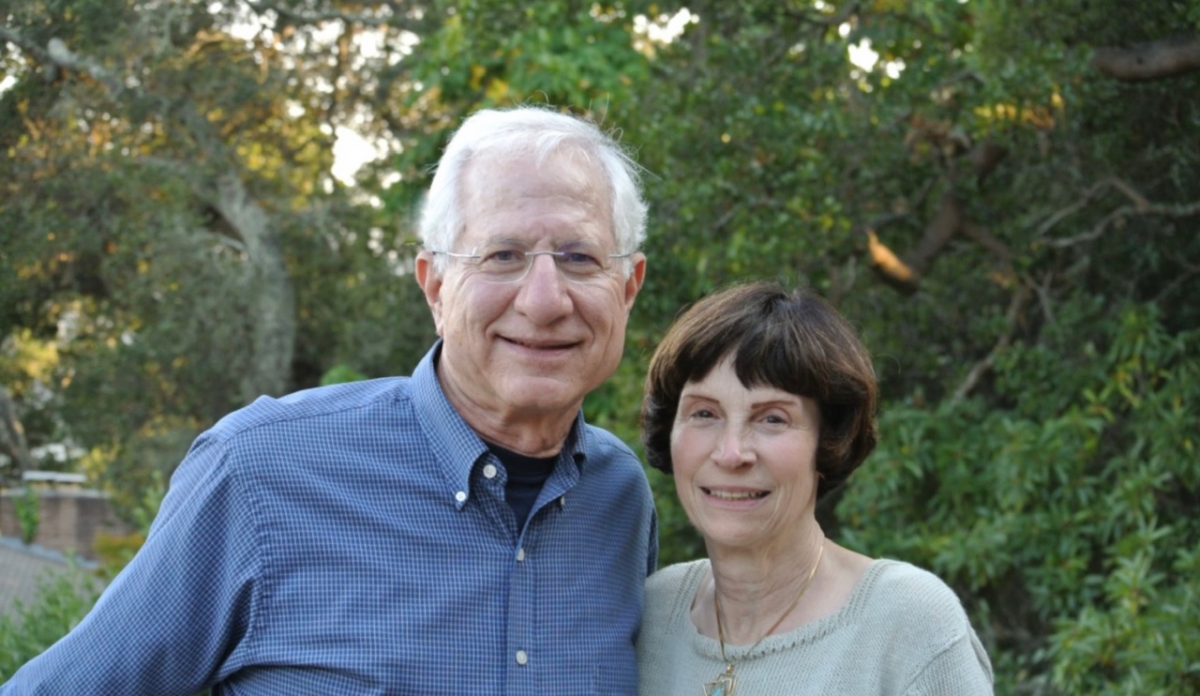 Photograph of a man with white hair and a woman with brown hair.