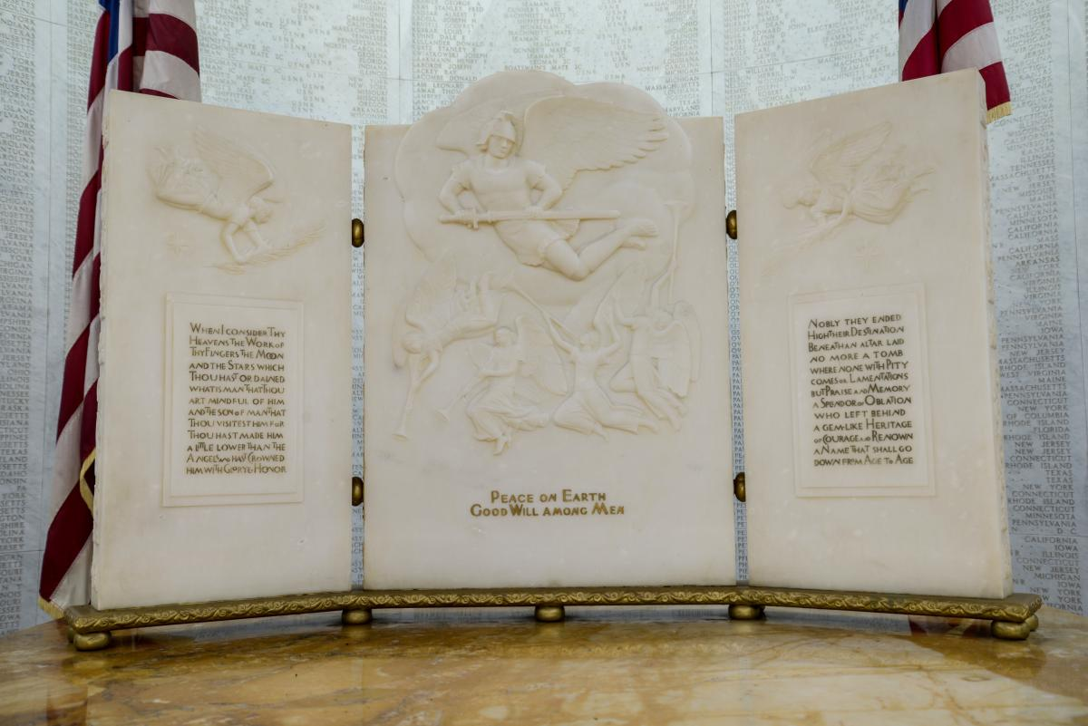 Marble triptych with carved reliefs featuring angles.