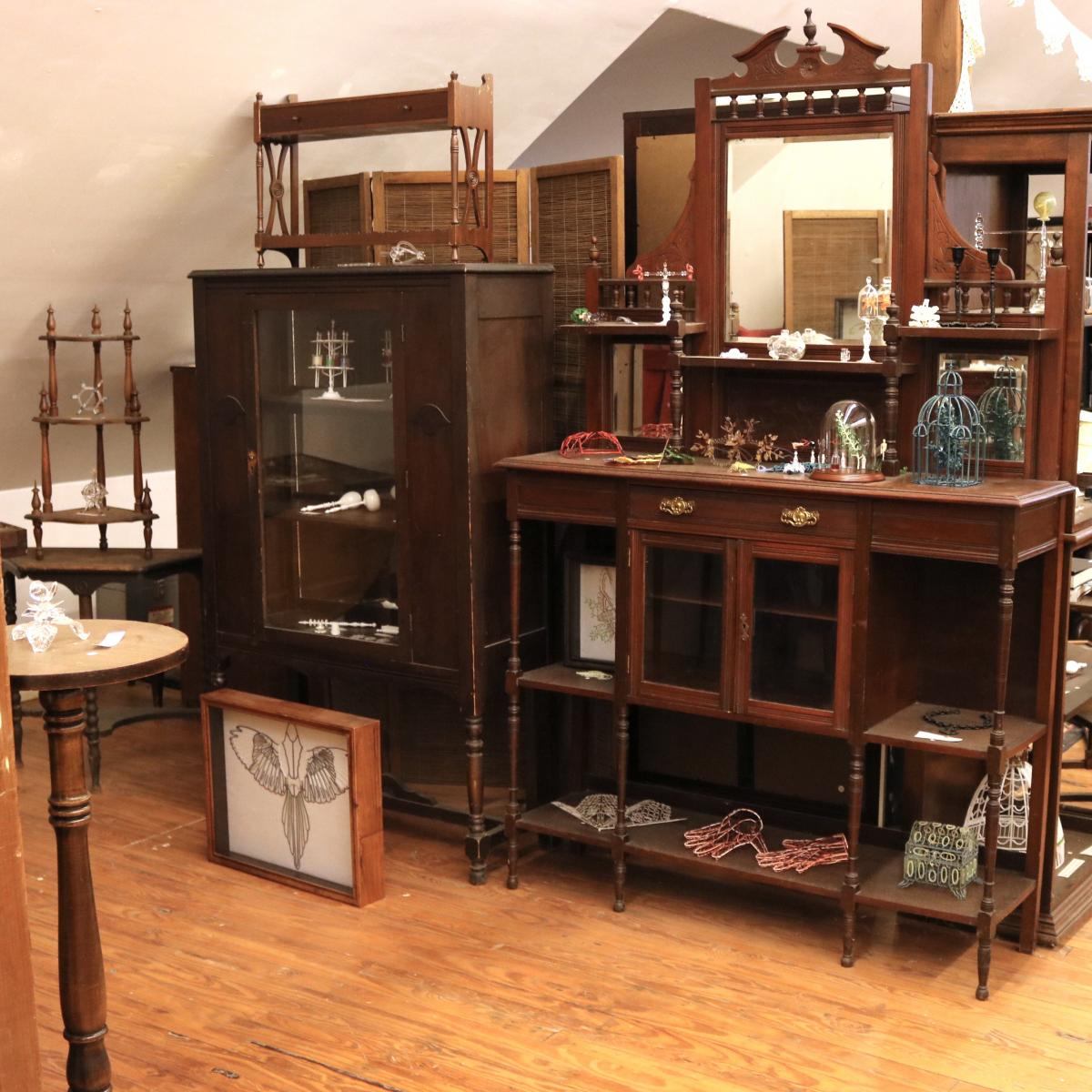 Shelves of furniture filled with objects used by the artist.