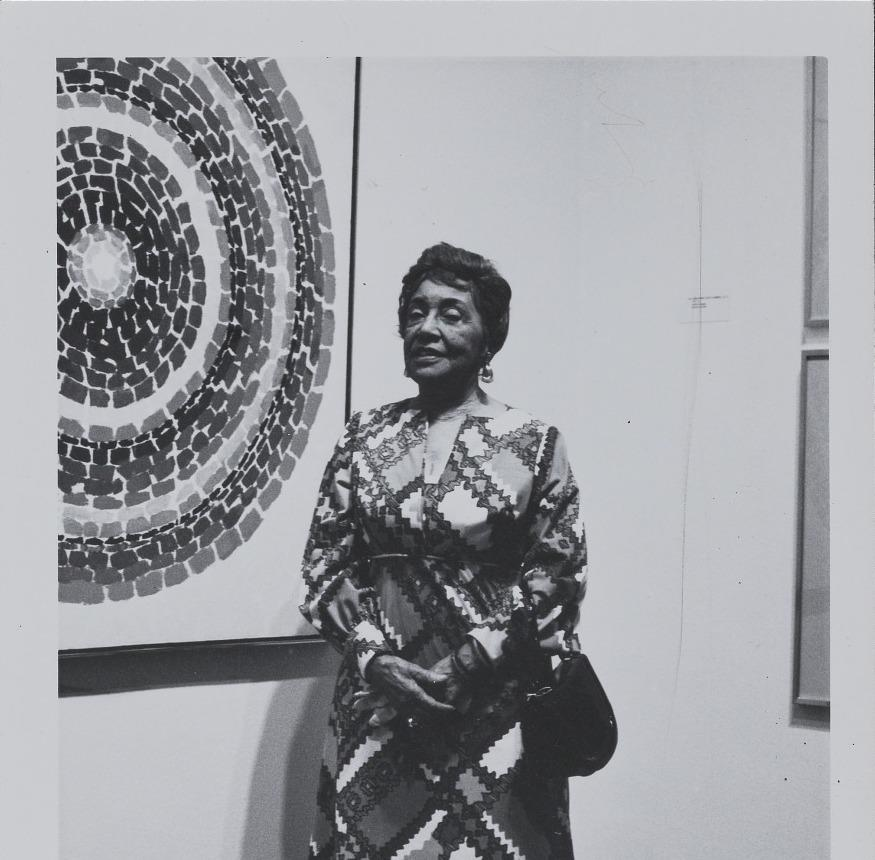 Painter Alma Thomas in front of one of her paintings in 1972