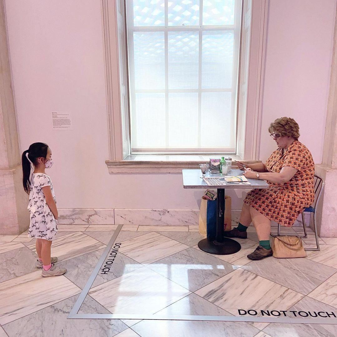 Small child looking at Woman Eating