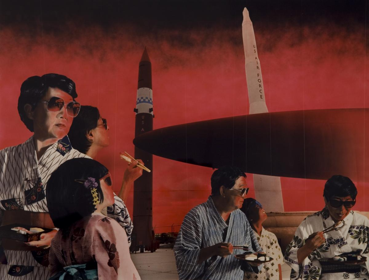Group of Japanese people wearing kimonos and eating sushi in the foreground with us air force missiles in the background