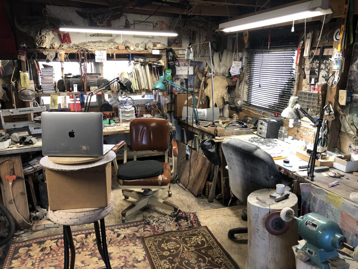 Cluttered artist studio with