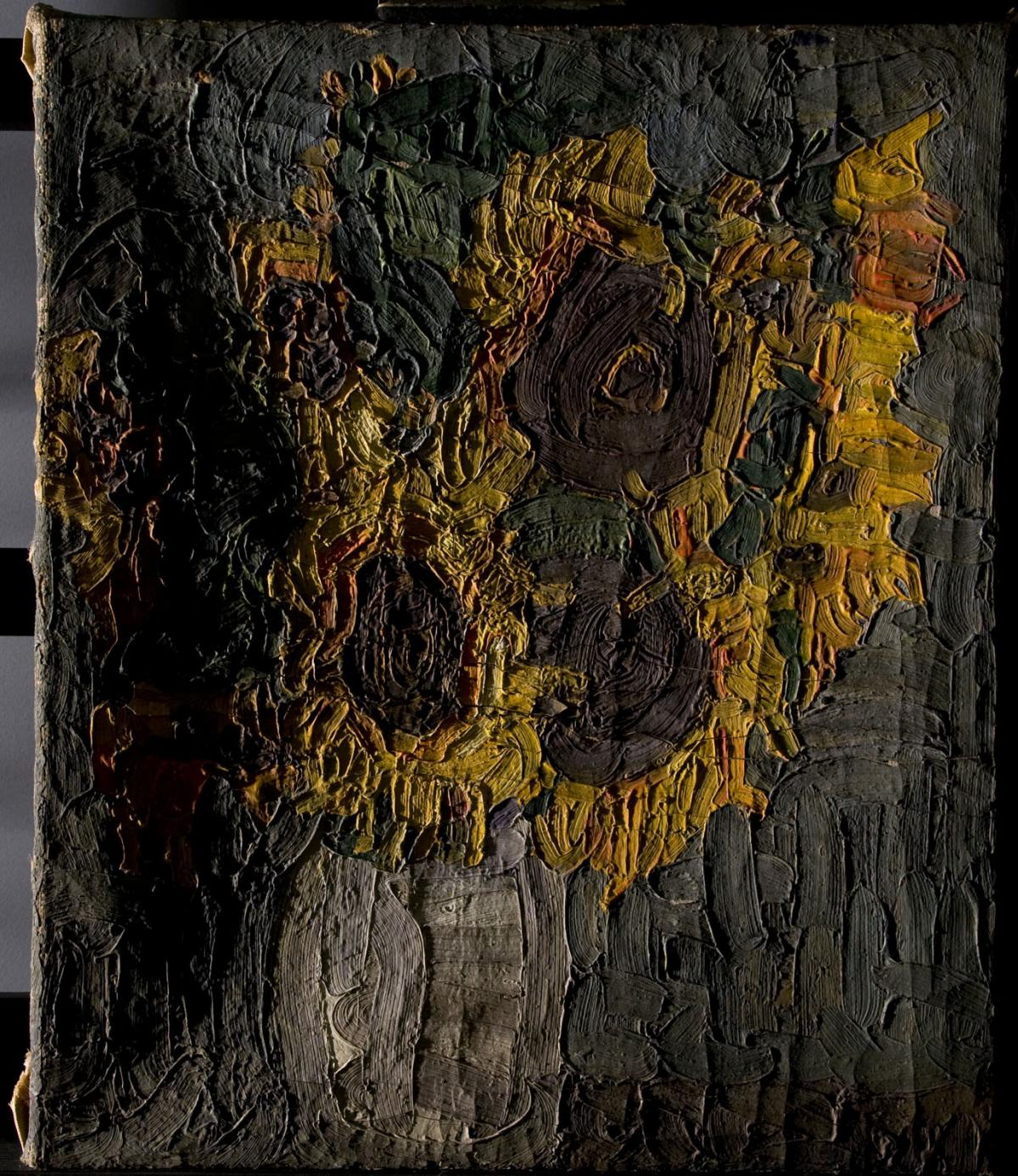 A damaged painting of sunflowers before conservation