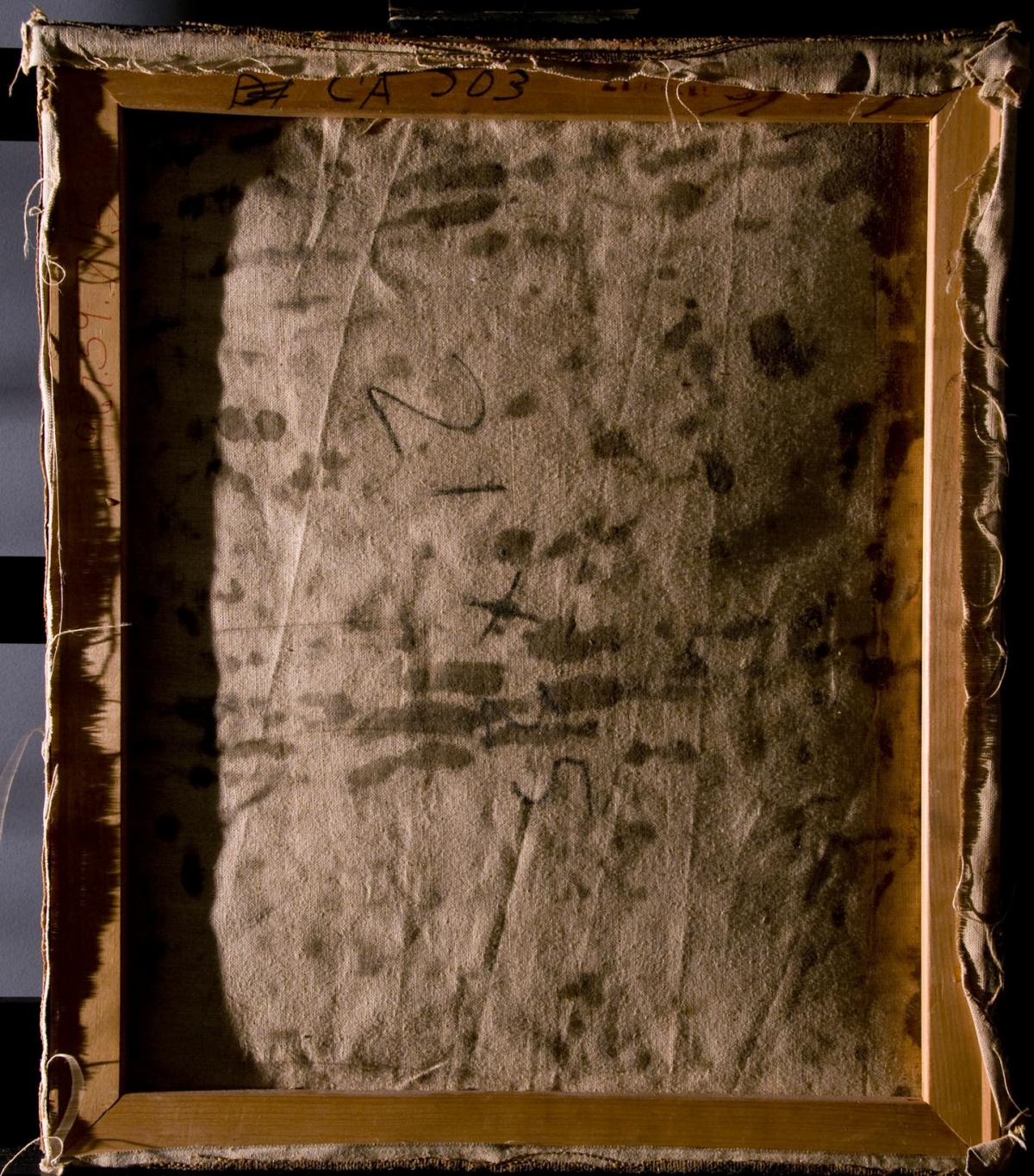The back of a damaged painting shows staining before conservation