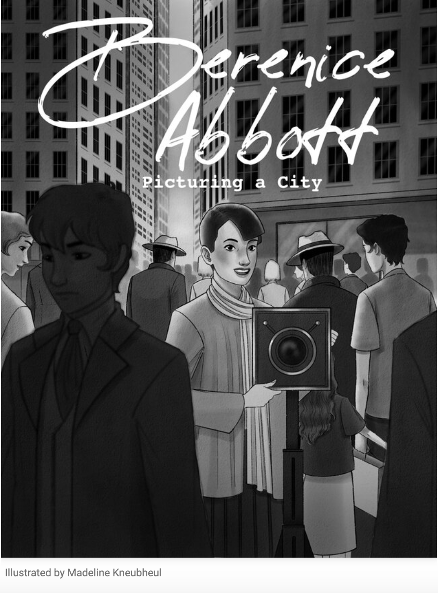 """A gray-and-white illustration depicts a bustling cityscape. A young woman with short dark hair, big eyes, and a bright smile stands behind a large camera on a tripod. Around her is a street filled with people all going in different directions with tall buildings rising above them.  At the top of the page, text reads, """"Berenice Abbott: Picturing a City."""""""