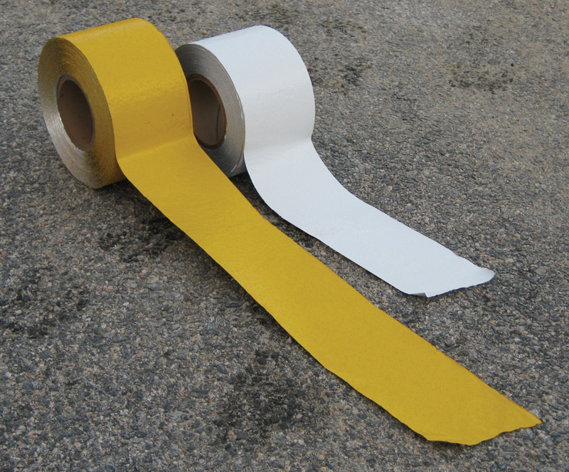 One Roll of Yellow Pavement Marking Tape and One Roll of White Pavement Marking Tape Rolled Out