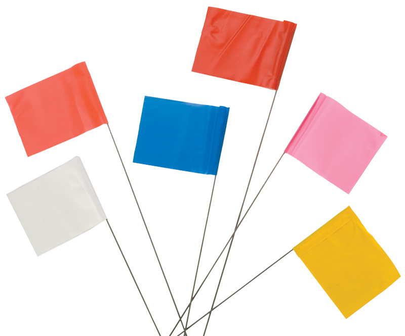 Six Multicolored Marking Flags Laid Down