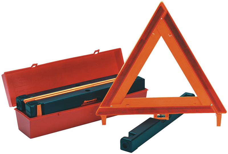 Orange Triangular Safety Warning Signs With A Highway Safety Kit Next To It
