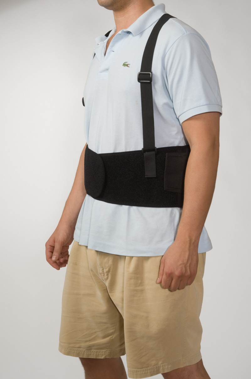 Man Standing Up Wearing Black Back Brace For Lifting