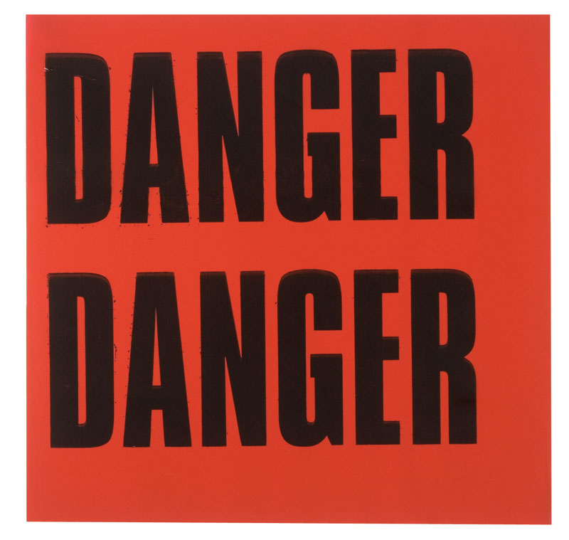 Orange Warning Flags With Danger Printed Twice In Black Text