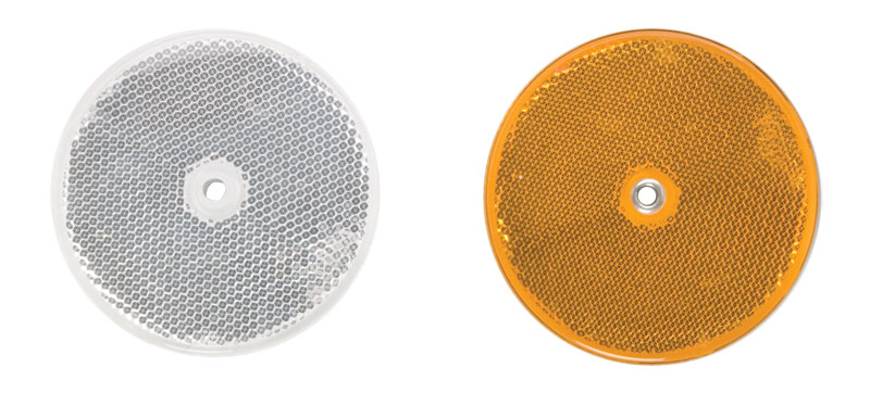 Two Highway Reflectors With One White On The Left And One Yellow On The Right